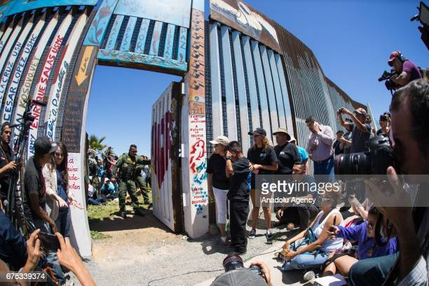 Border Patrol agent closes the door after 6 families gathered at the border gather at the USMexico Border during the opening of the door at the US...