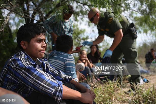 Border Patrol agent collects personal items from Central American families who crossed into the United States seeking asylum on April 14 2016 in Roma...