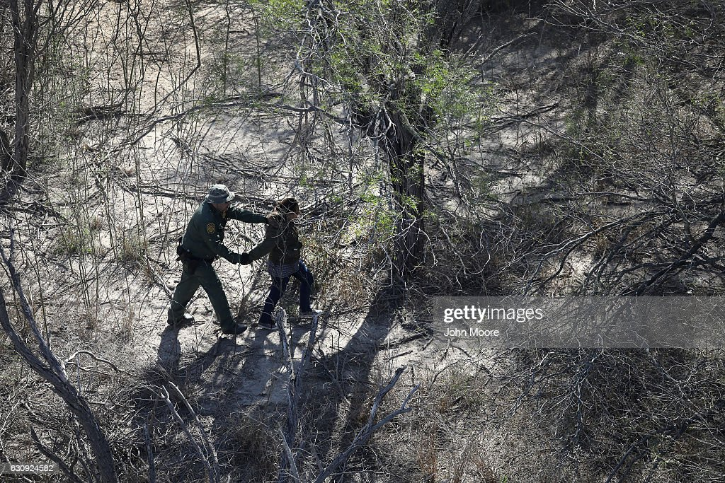S. Border Patrol agent detains an undocumented immigrant near the U.S.-Mexico border on January 3, 2017 near Mission, Texas. Thousands of undocumented immigrants are surging across the border ahead of the inauguration of President-elect Donald Trump, who campaigned on strengthening border security.