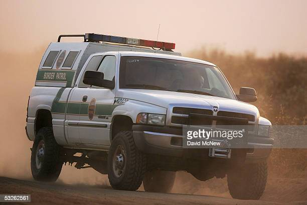 Border Patrol agent drives near the US-Mexico border fence at sunset as citizen volunteers prepare for their controversial nightly patrol in search...