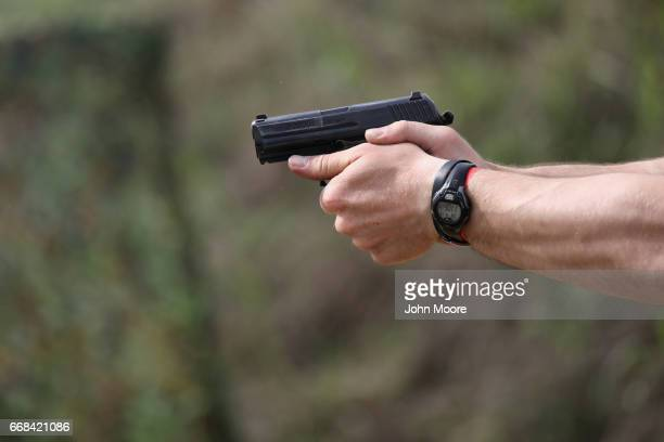 S Border Patrol agent fires a handgun during a shooting contest on April 13 2017 in Bandera Texas The gun competition was part of 'Demo Day' events...