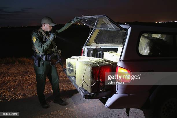 S Border Patrol Agent inspects a load of marijuana seized from drug smugglers near the USMexico border on April 10 2013 in Hidalgo Texas The agents...