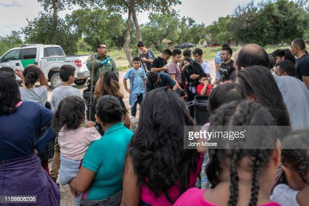 S Border Patrol agent instructs immigrants after they were taken into custody on July 02 2019 in Los Ebanos Texas Hundreds of immigrants most from...