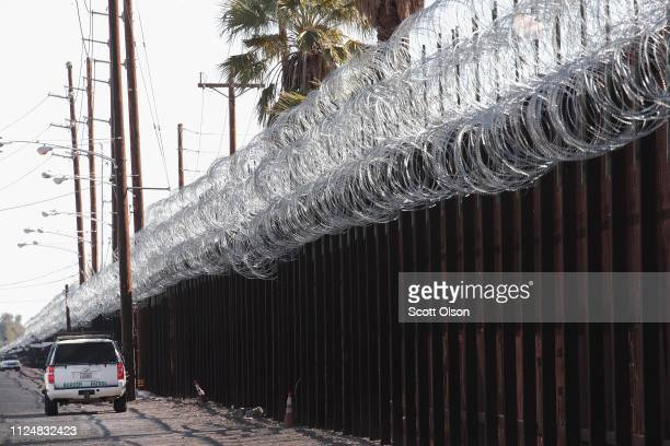 A border patrol agent keeps watch along the USMexico border on January 25 2019 near Calexico California The US government has been partially shut...