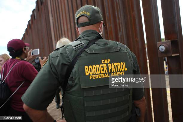 Border Patrol agent keeps watch at the Hugs Not Walls event on the U.S.-Mexico border on October 13, 2018 in Sunland Park, New Mexico. More than 200...