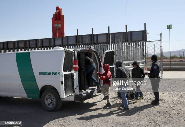 S Border Patrol agent loads detained migrants into a van at the border of the United States and Mexico on March 31 2019 in El Paso Texas US President...