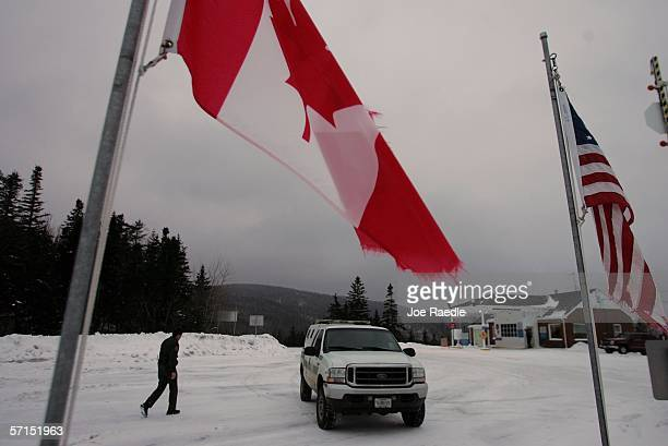 S Border Patrol Agent Mike Clark walks to his vehicle on patrol along the Canadian border near the border crossing point March 21 2006 at Pittsburg...