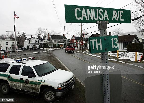 S Border Patrol Agent parks his vehicle on the US side of Canusa Avenue the two lane road that separates Canadian territory from the US March 22 2006...