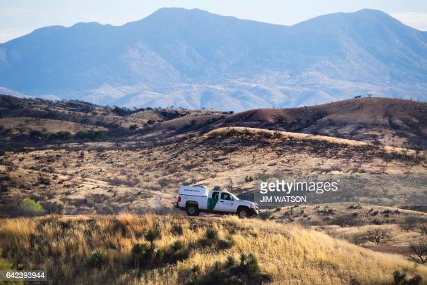 Border Patrol agent parks on a hill top near the border fence in Nogales Arizona on February 17 on the US/Mexico border this image is part of an...