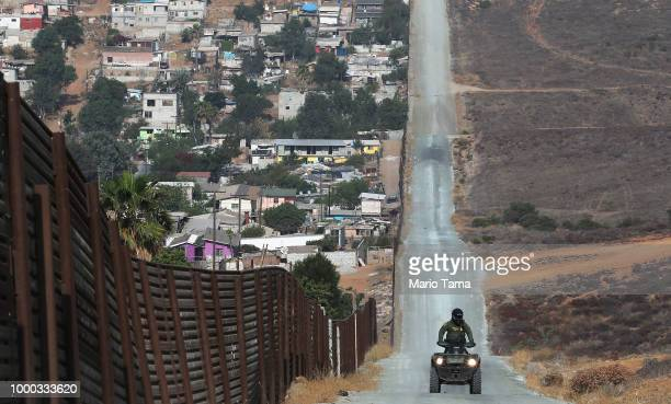 S Border Patrol agent patrols along a section of the USMexico border fence on July 16 2018 in San Diego California The entire Southwest border saw...