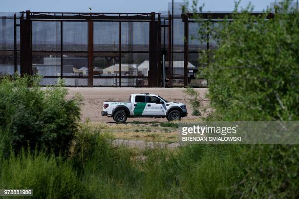 Border Patrol agent patrols the bed of the Rio Grand in front of where the US Customs and Boarder Protection is housing underage people caught...