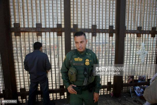 A Border Patrol agent patrols the USMexico border fence prior to an Easter mass at Friendship Park in San Ysidro California on Sunday April 16 2017 /...