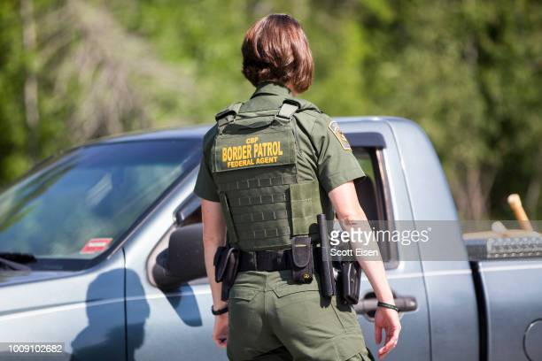 Border Patrol agent questions a driver at a highway checkpoint on August 1, 2018 in West Enfield, Maine. The checkpoint took place approximately 80...