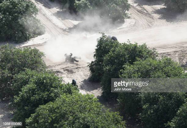 S Border Patrol agent recovers after crashing his ATV while in pursuit of undocumented immigrants through an orange grove on November 6 2018 in...
