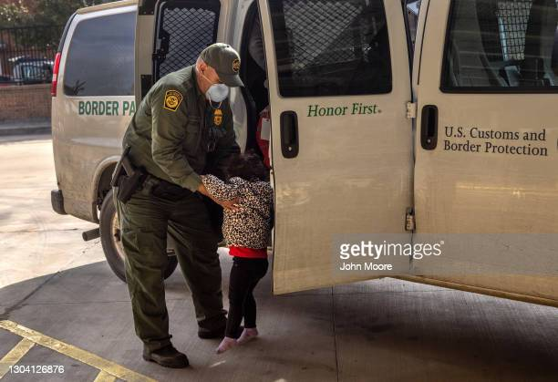 Border Patrol agent releases a young asylum seeker with her family at a bus station on February 25, 2021 in Brownsville, Texas. U.S. Immigration...