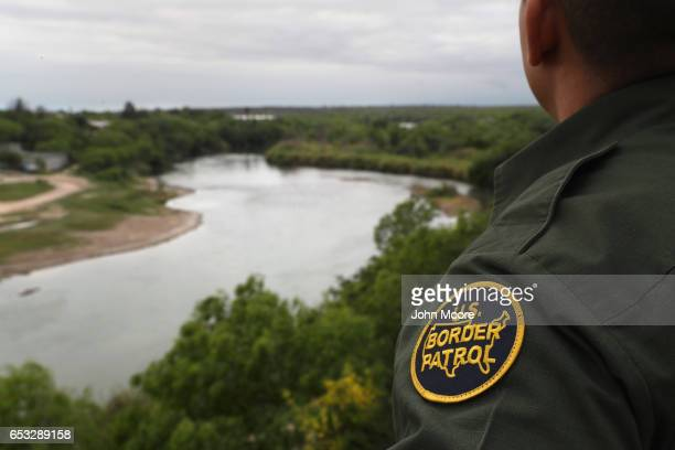 S Border Patrol agent scans the USMexico border while on a bluff overlooking the Rio Grande on March 13 2017 in Roma Texas The Border Patrol has...
