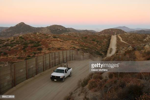 Border Patrol agent searches for tracks after a night of surveillance using nightvision equipment as agents carry out special operations near the...