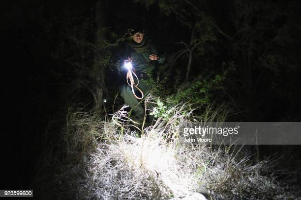 Border Patrol agent searches for undocumented immigrants on February 23, 2018 in McAllen, Texas. Thick brush covers the bank of the Rio Grande, which...