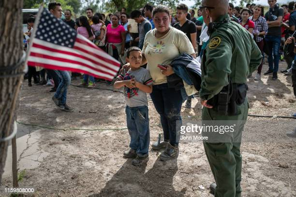 S Border Patrol agent speaks to immigrants after taking them into custody on July 02 2019 in Los Ebanos Texas Hundreds of immigrants most from...