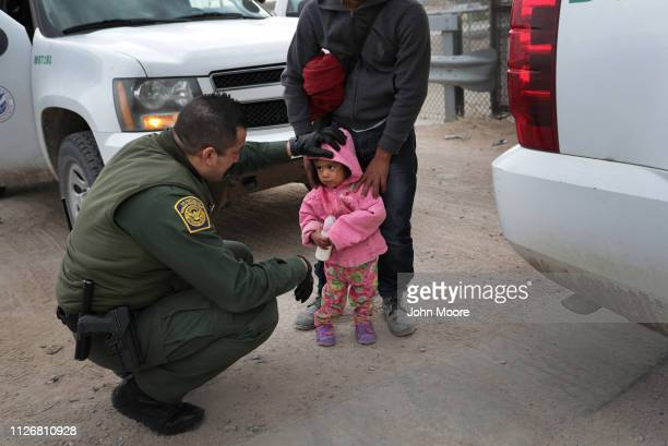 S Border Patrol agent speaks with Central American immigrants after they crossed the border from Mexico on February 01 2019 in El Paso Texas Agents...