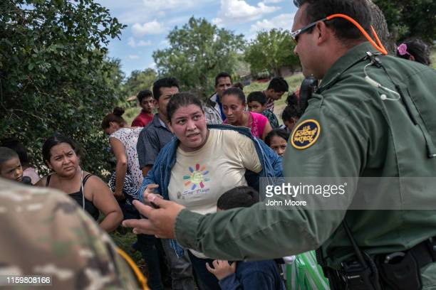 S Border Patrol agent speaks with immigrants after taking them into custody on July 02 2019 in Los Ebanos Texas Hundreds of immigrants most from...