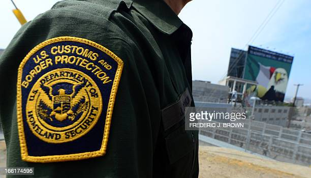 MACOR 'EEUUMIGRACIÓNSEGURIDADHISPANOS' A US Border Patrol agent stands near a crossing to Mexico at the San Ysidro port of entry along the USMexico...