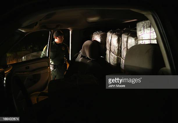 S Border Patrol agent stands near a pickup load of marijuana seized near the USMexico Border on April 11 2013 in Mission Texas Border Patrol agents...