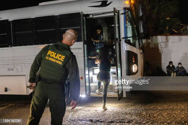 Border Patrol agent supervises as immigrants board a bus to a processing center on August 14, 2021 in Roma, Texas. Recent U.S. Customs and Border...
