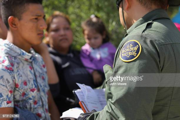 S Border Patrol agent takes a group of Central American asylum seekers into custody on June 12 2018 near McAllen Texas The immigrant families were...