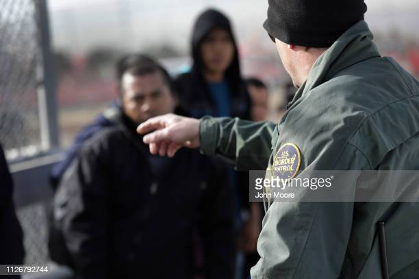 Border Patrol agent takes Central American immigrants into custody after they crossed the U.S. Mexico border on February 01, 2019 in El Paso, Texas....
