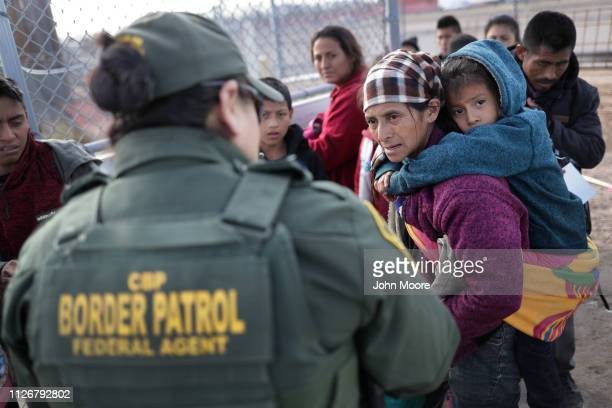 S Border Patrol agent takes Central American immigrants into custody after they crossed the US Mexico border on February 01 2019 in El Paso Texas The...