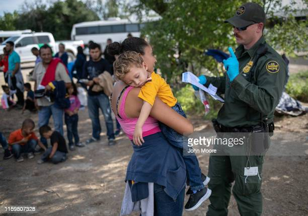 S Border Patrol agent takes down personal data from Salvadorian mother Ana Esmeralda and her son Manuel Alexander after they were taken into custody...