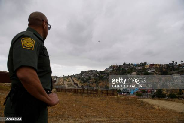 Border Patrol agent talks about a section of an older design fence remaining between new primary and secondary sections of the steel bollard-style...