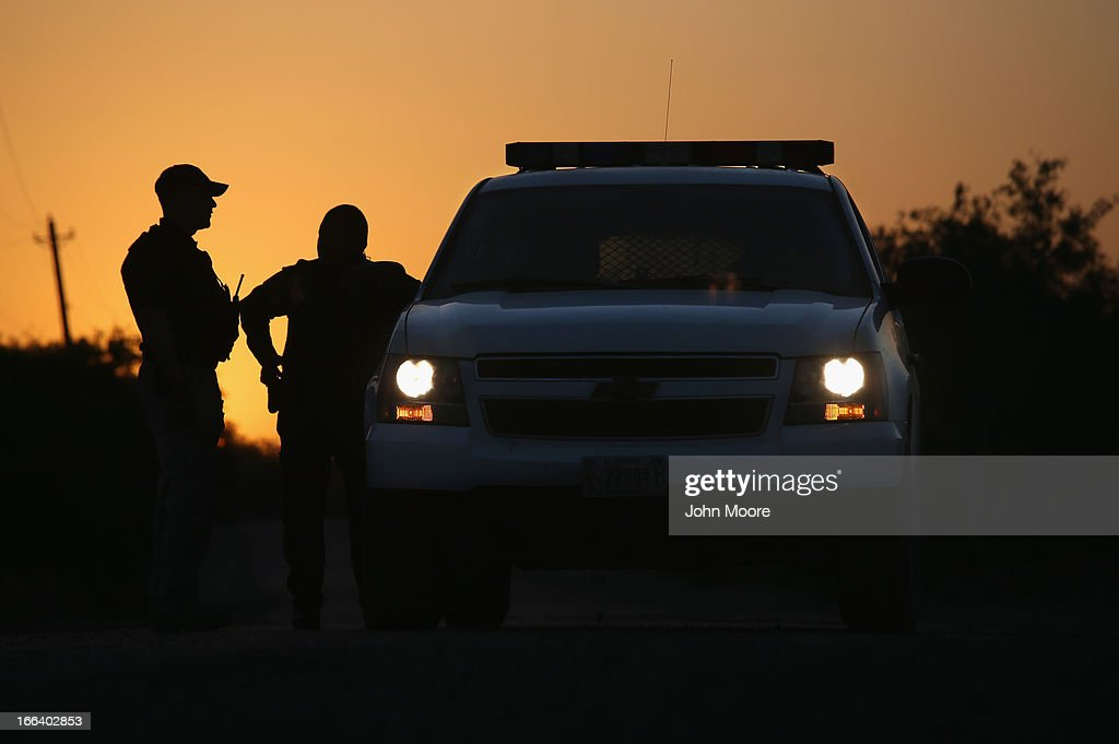 U.S. Border Patrol agents and a pilot from the U.S. Office of Air and Marine (OAM), stop to talk at sunset on April 11, 2013 in La Joya, Texas. In the last month the Border Patrol's Rio Grande Valley sector has seen a spike in the number of immigrants crossing the river from Mexico into Texas. With more apprehensions, they have struggled to deal with overcrowding while undocumented immigrants are processed for deportation. According to the Border Patrol, undocumented immigrant crossings have increased more than 50 percent in Texas' Rio Grande Valley sector in the last year. Border Patrol agents say they have also seen an additional surge in immigrant traffic since immigration reform negotiations began this year in Washington D.C. Proposed reforms could provide a path to citizenship for many of the estimated 11 million undocumented workers living in the United States.