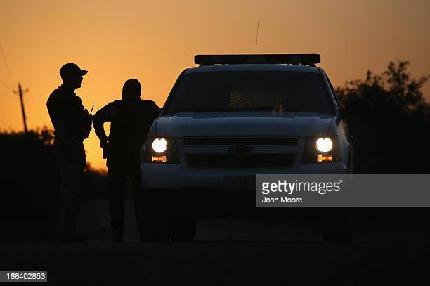 S Border Patrol agents and a pilot from the US Office of Air and Marine stop to talk at sunset on April 11 2013 in La Joya Texas In the last month...