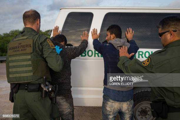 Border Patrol agents apprehend illegal immigrants shortly after they crossed the border from Mexico into the United States on Monday March 26 2018 in...