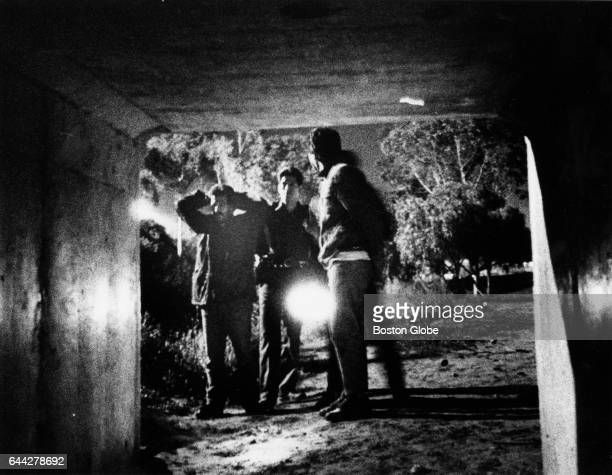 Border Patrol agents arrest two illegals caught hiding in the brush near a culvert on the US side of the US-Mexican border near San Ysidro, Calif.,...