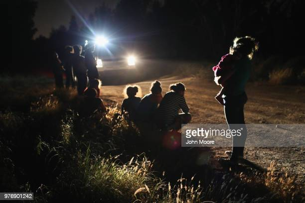S Border Patrol agents arrive to detain a group of Central American asylum seekers near the USMexico border on June 12 2018 in McAllen Texas The...