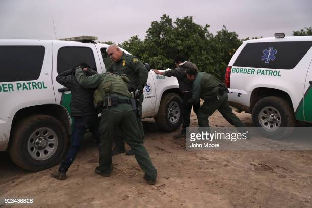 S Border Patrol agents body search undocumented immigrants from Central America after capturing them in a grapefruit orchard on February 22 2018 near...