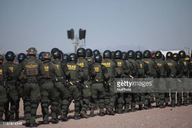 Border Patrol agents conduct a training exercise in the Anapra area, in front of the wall that divides Sunland Park, New Mexico, US, from Mexico, as...