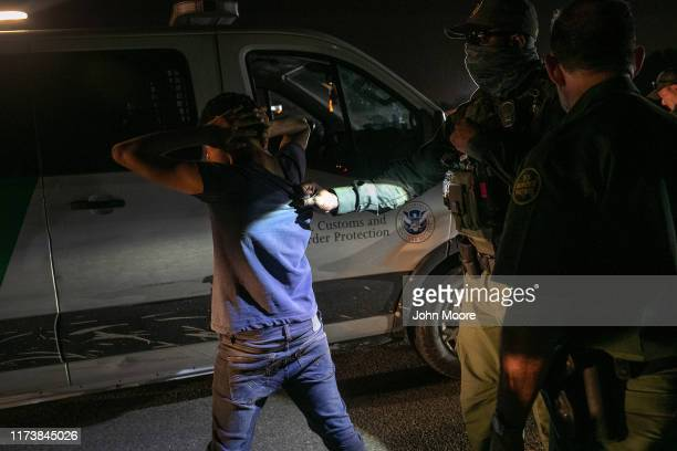 Border Patrol agents detain a 16-year-old undocumented immigrant minor from Mexico on September 10, 2019 in Mission, Texas. He had crossed the Rio...