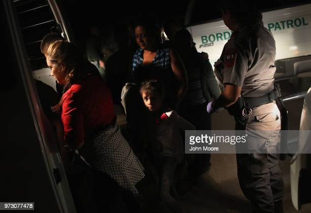 S Border Patrol agents detain a group of Central American asylum seekers near the USMexico border on June 12 2018 in McAllen Texas The group of women...