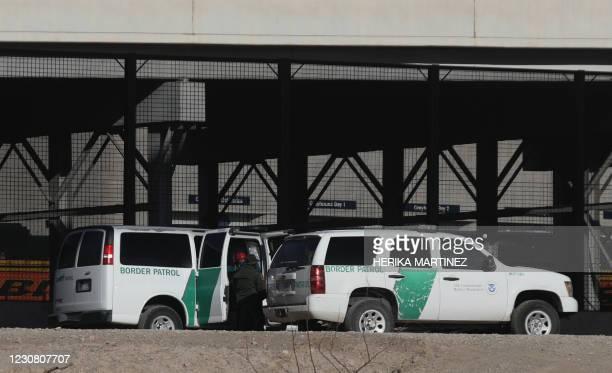 Border Patrol agents detain migrants after crossing the Rio Grande natural border between El Paso, state of Texas, US, and Ciudad Juarez, Chihuahua...
