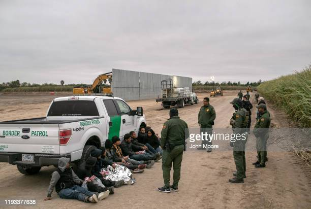 S Border Patrol agents detain undocumented immigrants caught near a section of privatelybuilt border wall under construction on December 11 2019 near...