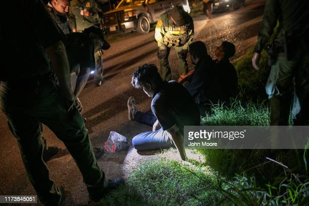 Border Patrol agents detain undocumented immigrants on September 10, 2019 in Mission, Texas. They had crossed the Rio Grande into Texas earlier in...