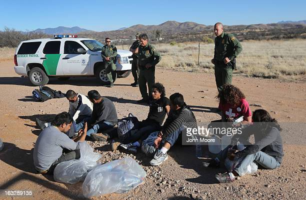 S Border Patrol agents guard a group of Mexican immigrants caught after they crossed into the United States on March 6 2013 near Walker Canyon...