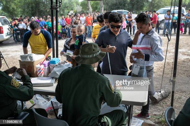 S Border Patrol agents interview immigrants including a blind man from El Salvador after taking them into custody on July 02 2019 in Los Ebanos Texas...