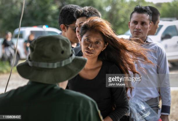 S Border Patrol agents interviews a Guatemalan immigrant after taking her into custody on July 02 2019 in Los Ebanos Texas Hundreds of immigrants...