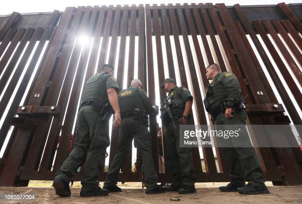 S Border Patrol agents lock the border wall gate at the conclusion of the Hugs Not Walls event on the USMexico border on October 13 2018 in Sunland...