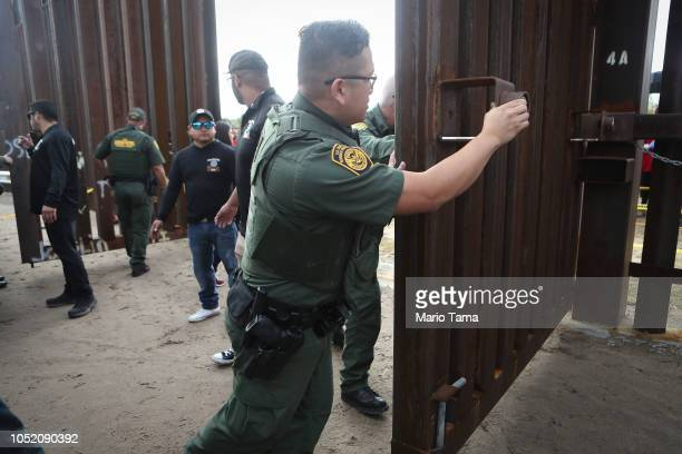 S Border Patrol agents open a border gate before the start of the Hugs Not Walls event on the USMexico border on October 13 2018 in Sunland Park New...